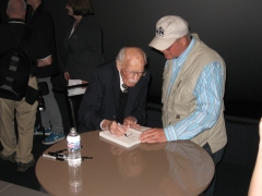 Bob Hoover signing autographs after the movie and Q&A session.